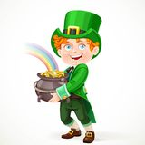 Cute boy in a Leprechaun suit with pot full of gold Stock Image