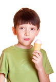Cute boy licking ice cream. Isolated on white background royalty free stock photography