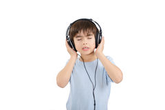 Cute boy is listening to music with eyes closed Royalty Free Stock Photography