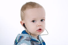 Cute boy listens music with headphones Royalty Free Stock Images