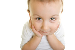 Cute boy looking. Cute boy holding his head Royalty Free Stock Photography