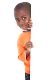 Cute boy looking around corner Stock Images