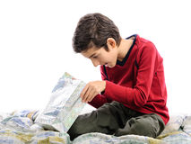 Cute boy looking in gift bag on birthday Royalty Free Stock Photography