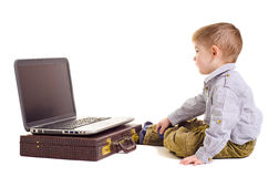 Cute boy looking at laptop screen. Isolated Stock Photography