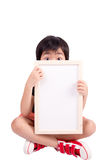 Cute boy is looking out from the blank banner Stock Image