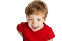 Cute Boy Looking Up. Smiling and laughing, wearing a red T-Shirt in a studio on a white background Stock Images