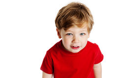 Cute Boy Looking Up. Wearing a red T-Shirt in a studio on a white background Stock Photo
