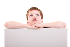 Cute  boy looking up with white board Royalty Free Stock Photos
