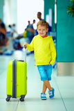 Cute boy with luggage in airport, ready for summer holidays Stock Photo