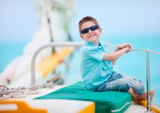 Cute boy on luxury yacht Stock Images
