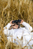 Cute boy lying down in a field of ripe wheat Stock Images