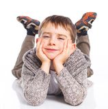 Cute boy lying on floor Royalty Free Stock Images