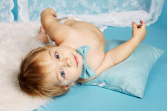 Cute boy lying on floor Royalty Free Stock Image