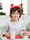 Cute Boy Making Christmas Greeting Card Stock Photos