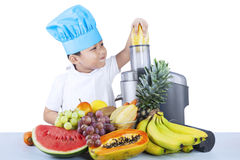 Cute boy is making fruit juice Stock Images