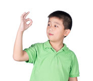 Cute boy making Ok sign isolated on white background Stock Images