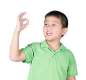 Cute boy making Ok sign isolated on white background Royalty Free Stock Photography