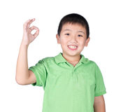 Cute boy making Ok sign isolated on white background Stock Photography