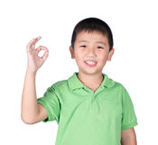 Cute boy making Ok sign isolated on white background Royalty Free Stock Photo
