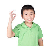 Cute boy making Ok sign isolated on white background Royalty Free Stock Images