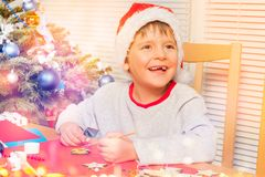 Cute boy making own Christmas ornaments at home Royalty Free Stock Photo