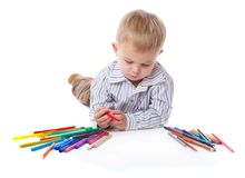 A cute boy with markers and pencils Stock Photography