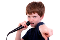 Cute boy with a microphone sings Stock Photography