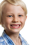 Cute boy with missing front teeth. Close-up portrait of a happy cute boy with two missing front teeth. Isolated on white Royalty Free Stock Photos