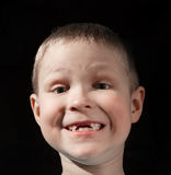 Cute boy missing some front teeth. Smiling Royalty Free Stock Photography