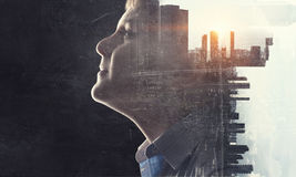 Cute boy and modern city . Mixed media Royalty Free Stock Images