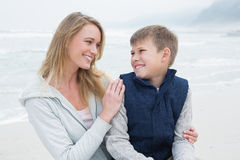 Cute boy with mother at beach Royalty Free Stock Photo