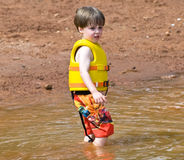 Cute Boy in the Mud Royalty Free Stock Photos