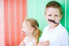 Cute boy with mustache party accessory Royalty Free Stock Photos