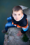 Cute boy near the lake stock images