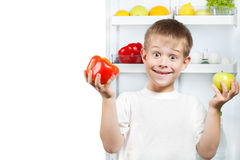 Cute boy near the open refrigerator Stock Photography