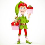 Cute boy the New Year's elf Santa's assistant gives gifts Stock Photo