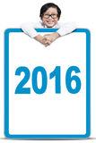 Cute boy with numbers 2016 on the board Stock Photo