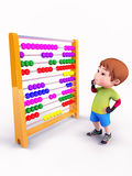 Cute boy observing the abacus machine Royalty Free Stock Image