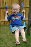 Cute Boy On Swing Stock Photo