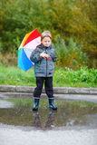 Cute boy outdoors at rainy day royalty free stock images