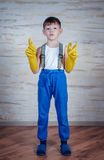 Cute boy in oversized rubber gloves Stock Photo
