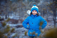 Cute boy with owl toy on shoulder in winter forest Stock Images