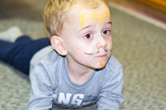 Cute   boy with painted face Stock Images