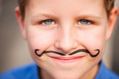 Cute boy with painted mustache Royalty Free Stock Photo