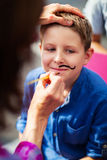 Cute boy with painted mustache Stock Image