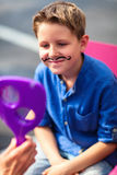 Cute boy with painted mustache Royalty Free Stock Image