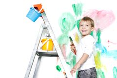 Cute boy paiting over white Royalty Free Stock Photo