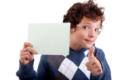 Cute boy with a paperboard in hand Stock Photos