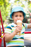 Boy in the park eating ice cream Royalty Free Stock Photo