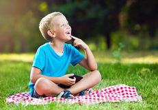 Cute boy in a park thinking Royalty Free Stock Photography